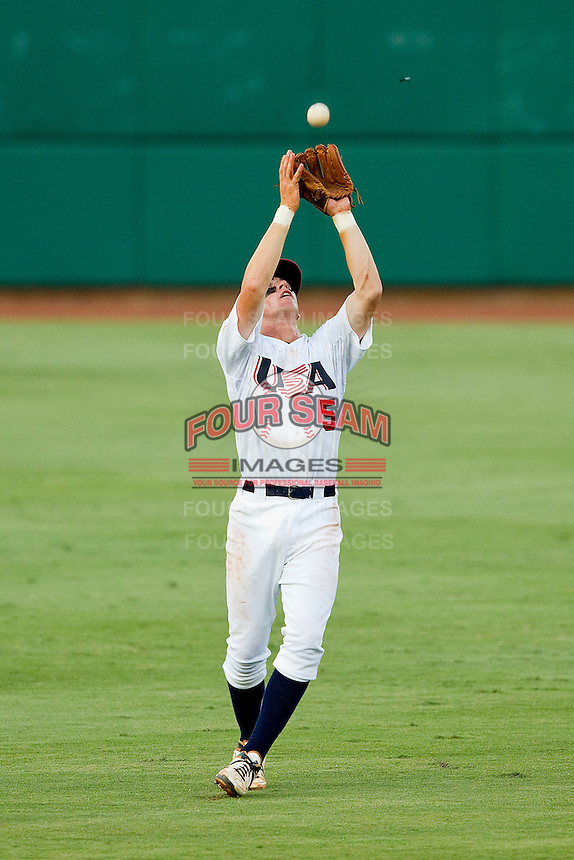 Shortstop Mikey White #5 of the USA 18u National Team catches a pop fly in shallow left field against the USA Baseball Collegiate National Team at the USA Baseball National Training Center on July 2, 2011 in Cary, North Carolina.  The College National Team defeated the 18u team 8-1.  Brian Westerholt / Four Seam Images