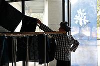 Ethnic Bouyei fashion designer Wei Xianglong works at his studio in Duyu, Guizhou Province, 2018.