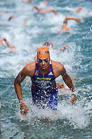 29 JUN 2014 - CHICAGO, USA - Aurelien Raphael (FRA) of France leads the field out of the water at the end of the first swim lap during the elite men's ITU 2014 World Triathlon Series round in Grant Park, Chicago in the USA (PHOTO COPYRIGHT © 2014 NIGEL FARROW, ALL RIGHTS RESERVED)