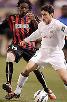 The MetroStars' Fabian Taylor looks to tackle the Revolution's Jay Heaps. The New England Revolution were defeated by the MetroStars 3 to 2 on Saturday September 11, 2004 at Giant's Stadium, East Rutherford, NJ..