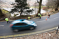 Temporary traffic lights controlling road works protecting workmen laying cable for British Telecom BT UK..©shoutpictures.com..john@shoutpictures.com