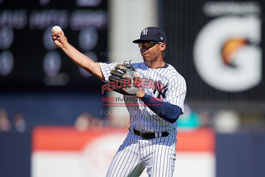 New York Yankees second baseman Gleyber Torres (25) throws during a Grapefruit League Spring Training game against the Toronto Blue Jays on February 25, 2019 at George M. Steinbrenner Field in Tampa, Florida.  Yankees defeated the Blue Jays 3-0.  (Mike Janes/Four Seam Images)