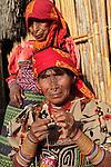 Two elder kuna women in traditional dress in Playon Chico village. San Blas Archipielago. Panama