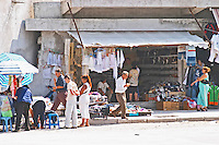 Street scene with street market with shoes and clothes. Shkodra. Albania, Balkan, Europe.