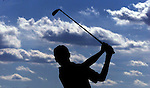 St Joseph High School's Corey Zogg, tees off at Bunker Hill Golf Course into the bright blue sky filled with afternoon clouds.