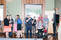 People stand around after Texas senator and Republican presidential candidate Ted Cruz spoke at a town hall put on by the Concerned Veterans for American at Milford Town Hall in Milford, New Hampshire.