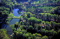 Aerial of the Golden Horseshoe Gold Golf Course in April at Colonial Williamsburg, Williamsburg, Virginia. The signature 18th hole is seen in the water. Recreation, Sports, Resorts. Williamsburg Virginia USA Tidewater.