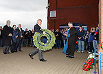 Celtic's Ian Bankier lays a wreath at the Ibrox disaster memorial along with John Greig