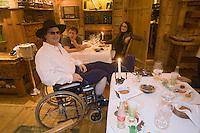 """Europe/France/Rhone-Alpes/74/Haute-Savoie/Megève: Restaurant """"La Ferme de mon Père"""" Marc Veyrat aprés un accident de ski en fauteuil roulant salue ses clients en salle<br /> PHOTO D'ARCHIVES // ARCHIVAL IMAGES<br /> FRANCE 2006"""
