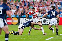 Japan Outside Centre Male Sa'u is tackled by Scotland Outside Centre Mark Bennett - Mandatory byline: Rogan Thomson - 23/09/2015 - RUGBY UNION - Kingsholm Stadium - Gloucester, England - Scotland v Japan - Rugby World Cup 2015 Pool B.