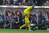 Saturday, 06 October 2012<br /> Pictured: Noel Hunt of Reading celebrating the second goal for his team with team mate Adrian Mariappa while the Swansea manager Michael Laudrup looks away in disappointment in the bench in the background.<br /> Re: Barclays Premier League, Swansea City FC v Reading at the Liberty Stadium, south Wales.