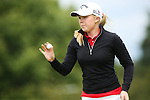 Stephanie Meadow waves to the crowd after her putt on the 8th green at the LPGA Championship 2014 Sponsored By Wegmans at Monroe Golf Club in Pittsford, New York on August 13, 2014