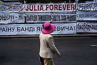 """UKRAINE, Kiev, 2/06/2012.Une Ukrainienne portant un chapeau passe devant une affiche disant """"Julia Forever"""" quelques jours avant le coup d'envoi de l'Euro 2012 de Football co-organisé par l'Ukraine et la Pologne..UKRAINE, Kiev, 2012/06/2..A Ukrainian wearing a hat passes a poster telling """"Julia Forever """" few days before the kickoff of the Euro 2012 Football co-hosted by Ukraine and Poland..© Pierre Marsaut / Est&Ost Photography"""