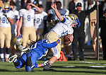 Carson's Ikela Lewis tackles Reed quarterback Matt Denn during the NIAA D-1 Northern Regional title game at Bishop Manogue High School in Reno, Nev., on Saturday, Nov. 29, 2014. Reed won 28-25.<br /> Photo by Cathleen Allison