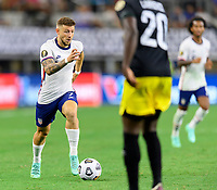 DALLAS, TX - JULY 25: Paul Arriola #7 of the United States brings the ball up the field during a game between Jamaica and USMNT at AT&T Stadium on July 25, 2021 in Dallas, Texas.