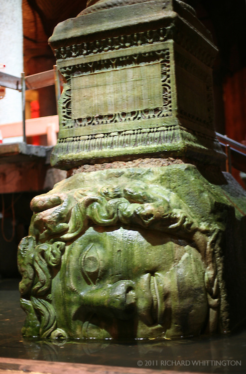 In the Basilica Cistern, a column rests on a base carved as Medusa's head.