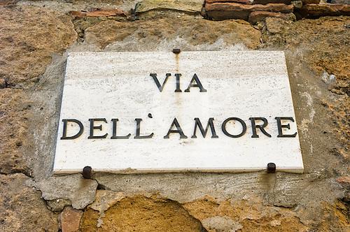 Pienza, Tuscany, Italy. Via dell' amore sign on wall.