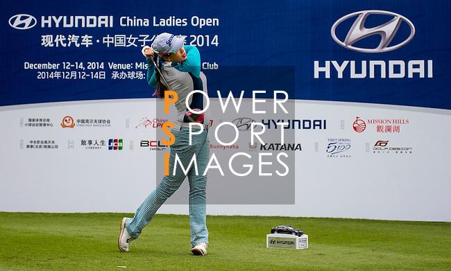 Panpan Yan of China in action during the Hyundai China Ladies Open 2014 on December 12 2014, in Shenzhen, China. Photo by Li Man Yuen / Power Sport Images