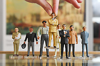 """BNPS.co.uk (01202 558833)<br /> Pic: ZacharyCulpin/BNPS<br /> <br /> Pictured: Corgi Icon Figures including a safari suited Roger Moore as 007 and Sean Connery to his right with a rouges gallery of villans behind them, including, Blofeld, Odd Job, Jaws, Scaramanga, Drax, and  Dr. No, <br /> <br /> An exact replica of the secret weapons case used by Sean Connery's 007 in From Russia With Love has emerged for sale for £14,000. <br /> <br /> The black attache case is one of only 100 models ever produced and has been described by experts as the """"holy grail"""" of James Bond memorabilia. <br /> <br /> The replica is to be sold alongside dozens of sought-after Bond items, including a set of 21 hand painted Corgi model figures, at Ewbank's Auctions of Woking, Surrey."""