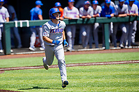 Florida Gators catcher Nathan Hickey (11) hustles down the first-base line against the Tennessee Volunteers on Robert M. Lindsay Field at Lindsey Nelson Stadium on April 11, 2021, in Knoxville, Tennessee. (Danny Parker/Four Seam Images)