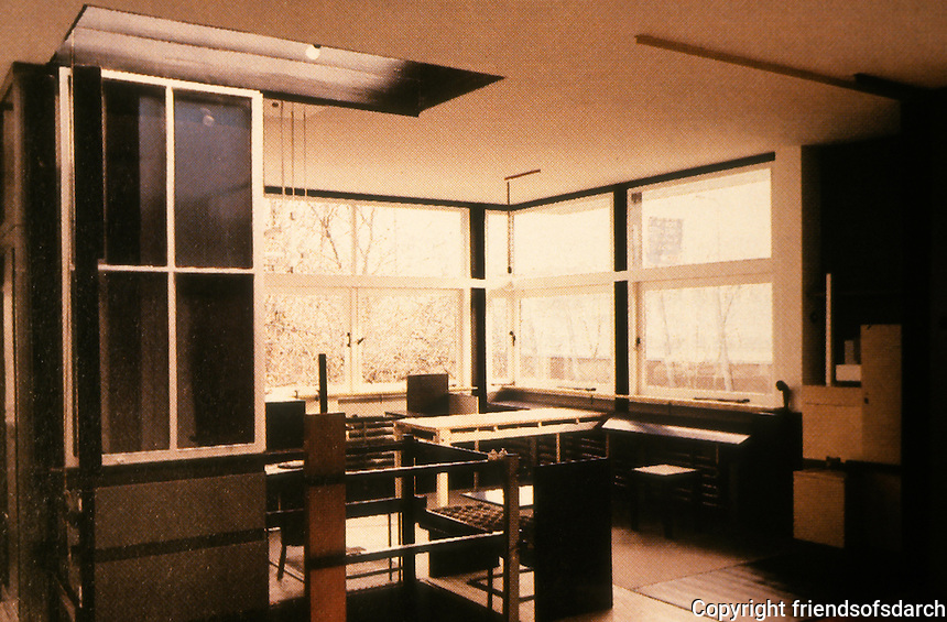 Gerrit Rietveld: Schroder House. First floor, sliding partitions opened with view of stairwell/living and dining room area. Mrs. Schroder's bedroom out of sight to left.