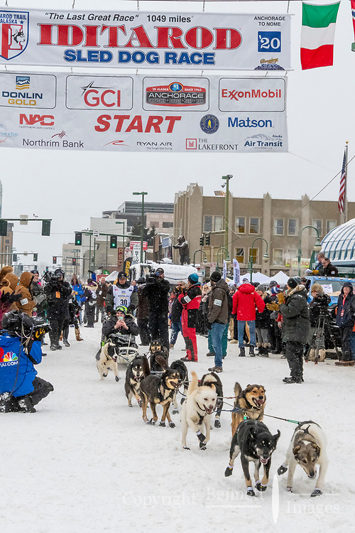 Tom Knolmayer  and team leave the ceremonial start line with an Iditarider and handler at 4th Avenue and D street in downtown Anchorage, Alaska on Saturday March 7th during the 2020 Iditarod race. Photo copyright by Cathy Hart Photography.com