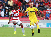 Fleetwood Town's Peter Clarke clears the danger away from Doncaster Rovers' Niall Ennis<br /> <br /> Photographer David Shipman/CameraSport<br /> <br /> The EFL Sky Bet League One - Doncaster Rovers v Fleetwood Town - Saturday 17th August 2019  - Keepmoat Stadium - Doncaster<br /> <br /> World Copyright © 2019 CameraSport. All rights reserved. 43 Linden Ave. Countesthorpe. Leicester. England. LE8 5PG - Tel: +44 (0) 116 277 4147 - admin@camerasport.com - www.camerasport.com