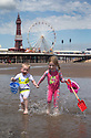 30/06/15<br /> <br /> Cristin (5) and Daryl (2) Anderson.<br /> After a morning of cloud,  hot sunny weather finally arrived arrived at lunchtime today.<br /> <br /> All Rights Reserved - F Stop Press.  www.fstoppress.com. Tel: +44 (0)1335 418629 +44(0)7765 242650