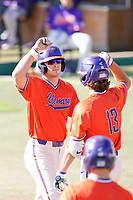 Chad Fairey (11) of the Clemson Tigers is greeted after scoring a run in a fall Orange-Purple intrasquad scrimmage on Saturday, November 14, 2020, at Doug Kingsmore Stadium in Clemson, South Carolina. (Tom Priddy/Four Seam Images)