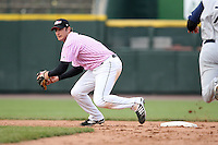 May 10, 2009:  Second Baseman Matt Macri of the Rochester Red Wings, Triple-A International League affiliate of the Minnesota Twins, attempts to turn a double play during a game at Frontier Field in Rochester, NY.  The Red Wings wore special pink jerseys for Mothers Day.  Photo by:  Mike Janes/Four Seam Images