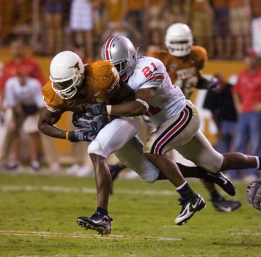 09 September 2006: Texas receiver Limas Sweed is tackled by Ohio State defender Anderson Russell during the Texas Longhorns 24-7 loss to the Ohio State Buckeyes at Darrell K Royal Memorial Stadium in Austin, TX.