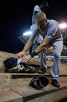 Trenton Thunder center fielder Trey Amburgey (14) puts down his glove and hat after an inning during a game against the Richmond Flying Squirrels on May 11, 2018 at The Diamond in Richmond, Virginia.  Richmond defeated Trenton 6-1.  (Mike Janes/Four Seam Images)