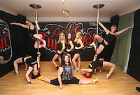 Pictured clockwise from bottom LEFT: Kimberley Jones, Reb Wilkshire, Laura Fidoe, Sian O'Shea, Tina Lediard, organiser Lisa Broughton and Emily Kennedy (FRONT). Saturday 22 February 2014<br /> Re: Eight women have attempted to set a new world record of most people pole dancing at the same time.<br /> Pole 4 Life world record attempt was organised by Lisa Broughton at her Pole Twisters dance studio in Cardiff.<br /> The women had to pole dance for six minutes to set the new record.
