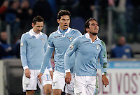 Calcio, semifinale di ritorno di Coppa Italia: Lazio vs Juventus. Roma, stadio Olimpico, 29 gennaio 2013..Lazio midfielder Alvaro Gonzalez, of Uruguay, right, celebrates with teammates Hernanes, center, and Miroslav Klose after scoring during the Italy Cup football semifinal return leg match between Lazio and Juventus at Rome's Olympic stadium, 29 January 2013..UPDATE IMAGES PRESS/Riccardo De Luca