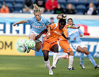 Chicago Red Star fowrad Ella Masar controls the ball in the air while being pressured by Sky Blue FC defender Anita Asante (5).  The Sky Blue FC defeated the Chicago Red Stars 2-0 at Toyota Park in Bridgeview, IL on May 10, 2009.