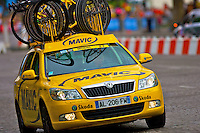 The Mavic neutral service car leads the peleton onto the Champs Elysees in Paris during the Tour de France, July 25th 210
