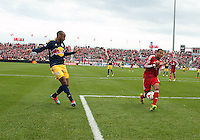 Toronto, Ontario - May 17, 2014: New York Red Bulls forward Thierry Henry #14 attempts to kick a ball past Toronto FC defender Justin Morrow #2 during a game between the New York Red Bulls and Toronto FC at BMO Field. Toronto FC won 2-0.