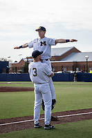 Michigan Wolverines outfielder Miles Lewis (3) and first baseman Jimmy Kerr (15) pregame routine before the NCAA baseball game against the Eastern Michigan Eagles on May 8, 2019 at Ray Fisher Stadium in Ann Arbor, Michigan. Michigan defeated Eastern Michigan 10-1. (Andrew Woolley/Four Seam Images)