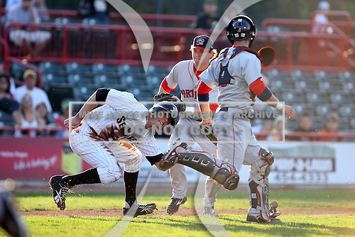 June 10th 2008:  Third baseman Andrew Pinckney (30) of the Portland Seadogs, Class-AA affiliate of the Boston Red Sox, tags out Jeff Frazier of the Erie Seawolves as catcher Mark Wagner looks on during a game at Jerry Uht Park in Erie, PA.  Photo by:  Mike Janes/Four Seam Images