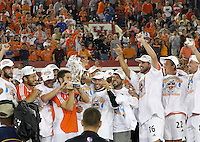 Houston Dynamo team captain Wade Barrett holds the Western Conference Championship trophy as fellow Dynamo teammates celebrate.   Houston Dynamo beat the Colorado Rapids 3-1 to clinch the Western Conference Championship at Robertson Stadium in Houston, TX on November 5, 2006.