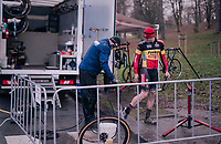Belgian National CX Champion Laurens Sweeck (BEL/Pauwels Sauzen-Bingoal) getting his mudded shoes cleaned post-race<br /> <br /> Men's Race<br /> UCI Cyclocross World Cup Namur 2020 (BEL)<br /> <br /> ©kramon