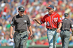 10 June 2012: Washington Nationals Manager Davey Johnson discusses an overturned call with umpire Dana DeMuth during a game against the Boston Red Sox at Fenway Park in Boston, MA. Harper scored the game winning run in the 9th inning as the Nationals defeated the Red Sox 4-3 to sweep their 3-game interleague series. Mandatory Credit: Ed Wolfstein Photo