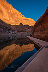The Pier at Rainbow Bridge  ©2017 James D. Peterson.  I recently had the great fortune to spend a couple days on Lake Powell with a good friend.  It was a fine trip in ideal weather for boating, and the beauty of that territory is pretty much indescribable. <br /> <br /> Rainbow Bridge is only accessible by boat (well, I guess you can also get there by backpacking a long distance, but my backpacking days are ancient history), and most photographers who go there head straight for the bridge to capture some images.  That, in fact, is what I did initially too.  But it's also a good idea to look around and make sure you don't miss the beauty to be found in other directions.<br /> <br /> I waited for some nice sunrise light to hit the bridge itself, but it's situated between canyon walls that blocked the early morning sunbeams.  Back at the pier, however, that glorious light was pouring into the canyon, making the walls glow and also creating a nice reflection in the water.  And in addition to the sublime light, I loved the geometry of the resulting scene.  So did my camera.