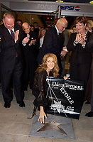 September 26. 2002, Montreal, Quebec, Canada; <br /> <br /> Bernard Landry, Quebec Premier (L) and Sheila Copps , Canadian Heritage Minister (R) watch as <br /> Celine Dion and  her husband Rene Angelil    unveil her Bronze Star at the Pepsi Forum's Walk of Fame, September 26 2002, Montreal, CANADA.