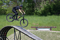 Brandon Korte of Centerton rides off of ramps, Friday, April 30, 2021 at the Railyard bike park in Rogers. Check out nwaonline.com/210501Daily/ for today's photo gallery. <br /> (NWA Democrat-Gazette/Charlie Kaijo)