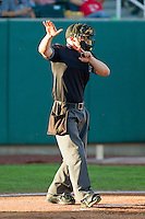 Home plate umpire Blake Mickelson signals a foul tip during the Pioneer League game between the Missoula Osprey and the Orem Owlz at Brent Brown Ballpark on July 23, 2012 in Orem, Utah.  The Owlz defeated the Osprey 6-1.  (Brian Westerholt/Four Seam Images)