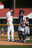 Team Stars catcher Hayden Dunhurst (53) (Ole Miss) has a meeting on the mound with starting pitcher Blade Tidwell (46) (Tennessee) during the game against Team Stripes at Burlington Athletic Park on July 3, 2021, in Burlington, North Carolina. The Stripes beat the Stars 7-4. (Brian Westerholt/Four Seam Images)