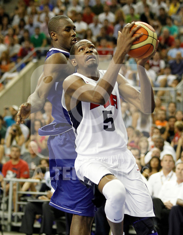 Spain's Serge Ibaka (l) and USA's Kevin Durant during friendly match.July 24,2012. (ALTERPHOTOS/Acero)