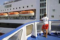 -  ferry of Moby Lines company leaves the port of Genoa<br /> <br /> - traghetto della compagnia Moby Lines lascia il porto di Genova