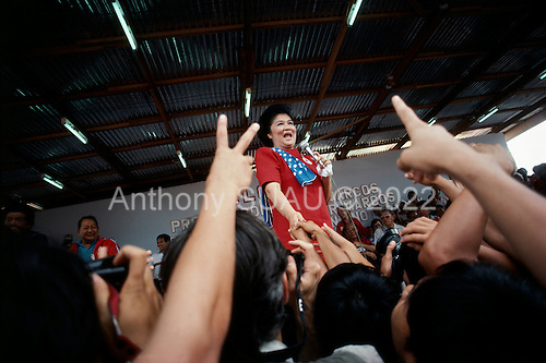 Bacolod, Philippines<br /> January 1986<br /> <br /> The irrepressible Imelda Marcos during her husbands re-election campaign.<br /> <br /> The People Power Revolution was a mostly nonviolent mass demonstration in the Philippines. ..In November 1985, President Ferdinand Marcos announced snap presidential elections be held in 1996, one year ahead of schedule. The opposition candidate was Corazon Aquino and Marcos himself ran for re-election. The elections were held on February 7. The electoral exercise was marred by widespread violence and tampering of election results. The official election canvasser, the Commission on Elections (COMELEC), declared Marcos the victor. The National Movement for Free Elections (NAMFREL), an accredited poll watcher, had Aquino as the winner. Due to the reports of alleged fraud, the Catholic Bishops Conference of the Philippines (CBCP) issued a statement condemning the elections. The United States Senate passed a resolution stating the same. <br /> <br /> Four days of action with millions of Filipinos taking to the streets in Manila led to the downfall of the authoritarian regime of President Marcos. The Marcos family fled the country and was transported by American helicopters to Clark Air Base in Angeles City, Pampanga, before heading on to Guam, and finally to Hawaii. Corazon Aquino was installed as the president of the Republic.